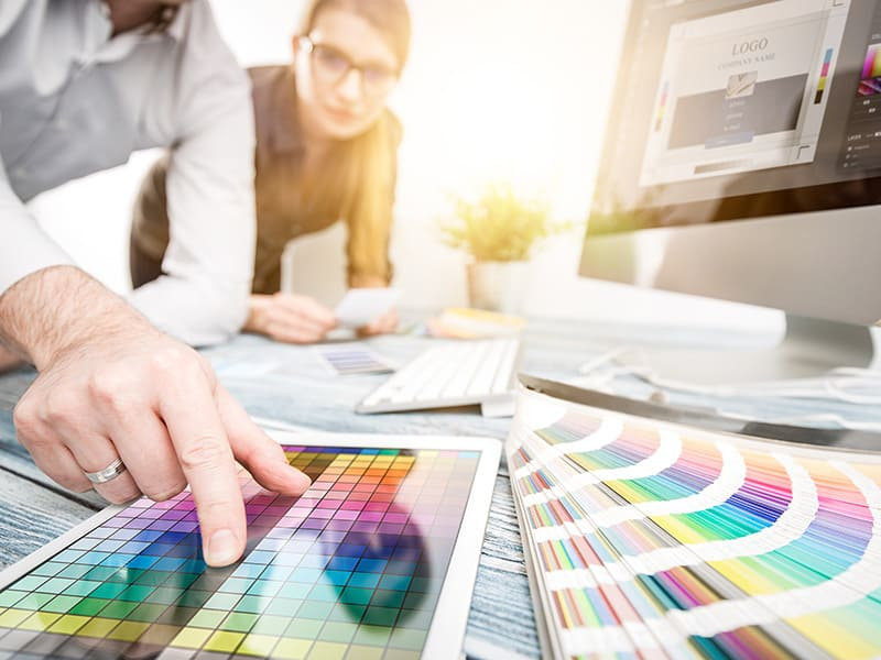 graphic designer with multitudes of color samples